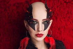 Woman nightmare make up. Woman nightmare. Creative dark make-up, conceptual idea for Halloween. Eerie nightmare turning into a black vampire, volume spikes body Royalty Free Stock Photos