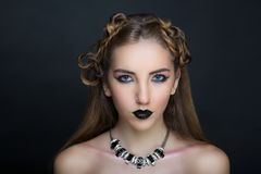 Woman nightmare make up. Woman nightmare. Creative dark make-up, conceptual idea for Halloween. Eerie beauty monster turning into black vampire, volume spikes Stock Photography