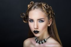 Woman nightmare make up. Woman nightmare. Creative dark make-up, conceptual idea for Halloween. Eerie beauty monster turning into black vampire, volume spikes Royalty Free Stock Photos