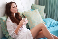 Woman in nightwear holding coffee Stock Photo