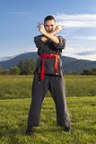 Woman ninja with shuriken Stock Photo