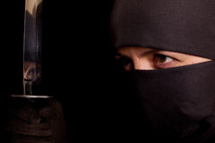 Woman in ninja suit Stock Image