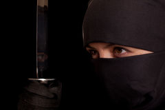 Woman in ninja suit royalty free stock photography