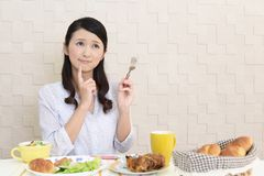 Woman with no appetite. Portrait of woman with no appetite in front of the meal stock photography
