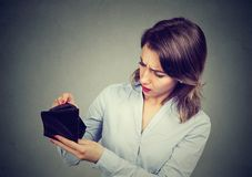 Woman with no money. Businesswoman holding empty wallet stock photo
