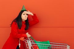 Girl Forgetting to Buy Something Important for Her Party. Woman with no shopping list failing to remember to buy some essential items royalty free stock photography