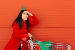 Girl Forgetting to Buy Something Important for Her Party. Woman with no shopping list failing to remember to buy some essential items stock image