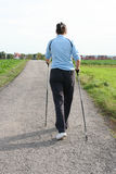 Woman on nordic walking Royalty Free Stock Photo