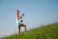 Woman nordic walking Royalty Free Stock Images