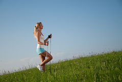 Woman nordic walking Stock Image