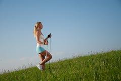 Woman nordic walking Stock Image