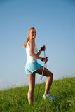 Woman nordic walking Royalty Free Stock Photography