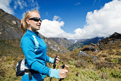 Woman nordic walking in mountains Stock Photography