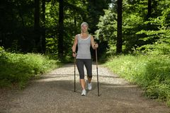 Woman nordic walking recreation sport Stock Photography