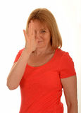 Woman nose snub gesture. Middle age woman giving a nose snub gesture with her hand. A sign of disrespect.  White background Royalty Free Stock Photos