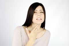 Woman almost not able to breeze because of asthma Stock Images