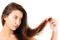 Woman is not happy with her fragile hair Royalty Free Stock Photos