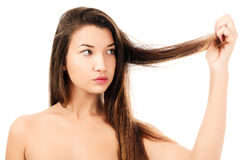 Woman is not happy with her fragile hair Royalty Free Stock Images