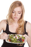 Woman not happy with salad Stock Images