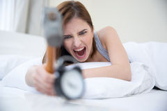Woman not wanting to get up Royalty Free Stock Photos