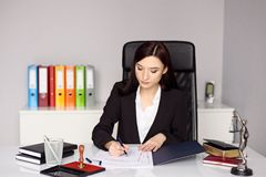 Woman notary public notarizes the power of attorney Royalty Free Stock Photos