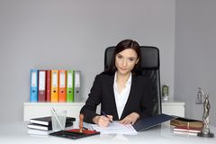 Woman notary public signing the power of attorney Royalty Free Stock Image