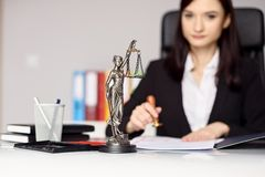 Woman notary public  stamping the document. Royalty Free Stock Photography