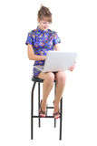 Woman with notebook. Young woman in Chinese dress with notebook on white background Royalty Free Stock Photo