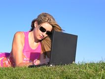Woman with notebook. On grass