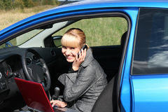 Woman with notebook in car Royalty Free Stock Photo