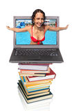 Woman from notebook computer on books stock photos