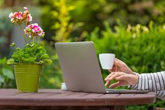 Woman with notebook on the garden Royalty Free Stock Photo