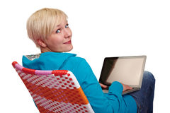 Woman with notebook looks over her shoulder Stock Image