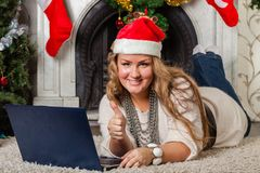 Woman with notebook near Christmas tree. Royalty Free Stock Photos