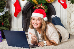 Woman with notebook near Christmas tree. Stock Photography