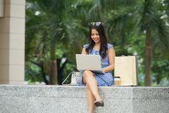 Woman with notebook outdoors royalty free stock photography