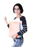 Woman with notebooks showing win gesture with fist Royalty Free Stock Photo