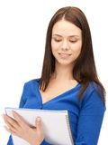 Woman with notepad. Bright picture of attractive woman with notepad Stock Photos