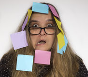 Woman with notes stuck on her Royalty Free Stock Images