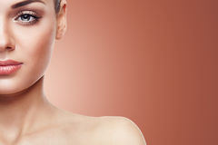 Woman with nude make up  on brown background Royalty Free Stock Images