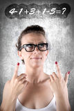 Woman and number. Happy woman solving mathematical problems Stock Photos