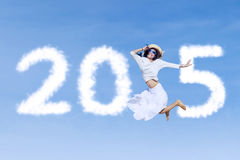 Woman with number 2015 on sky Stock Photo