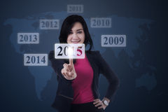 Woman with numbers 2015 on virtual screen Royalty Free Stock Images