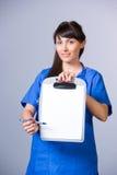 Woman Nurse chart Royalty Free Stock Photography