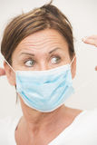 Woman nurse/doctor with mask over face Stock Photo