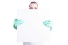 Woman nurse or doctor showing blank or empty  board Stock Image