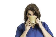 Woman Nurse Drinking Coffee or Tea Royalty Free Stock Image
