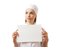 Woman nurse showing blank sign board, isolated. Royalty Free Stock Photos