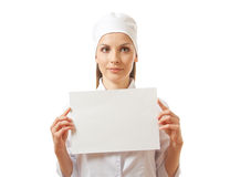 Woman nurse showing blank sign board, isolated. Stock Image