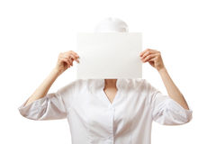 Woman nurse showing blank sign board, isolated. Stock Photos